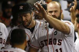 Astros' Evan Gattis could miss opening day after surgery - Photo