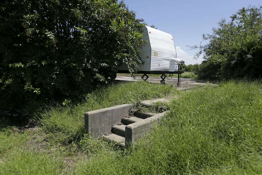 Steps that once led to a home destroyed by Hurricane Rita in 2005 now lead to a camper used as a residence by a storm victim. Photo: Gerald Herbert, Associated Press