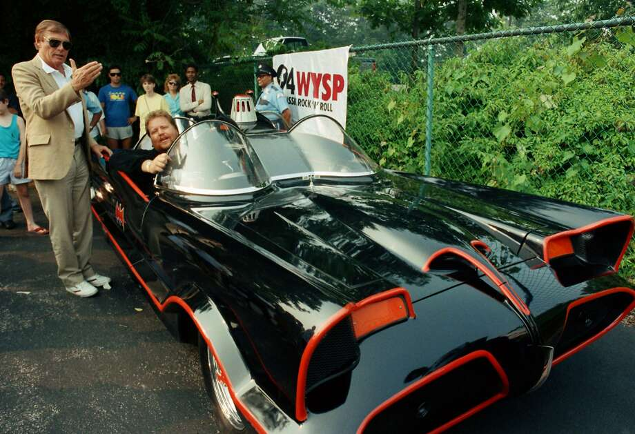 In this June 27, 1989 file photo, the original Batman, Adam West, left, stands beside the old Batmobile driven by owner Scott Chinery in Philadelphia. Batman won't have to worry about Batmobile knockoffs after a federal appeals court ruled the caped crusader's vehicle is entitled to copyright protection. The 9th U.S. Circuit Court of Appeals said Wednesday, Sept. 23, 2015, the Batmobile's bat-like appearance and other distinct traits make it a character that can't be replicated without permission from DC Comics, the copyright holder. Photo: Cristy Rickard, Associated Press