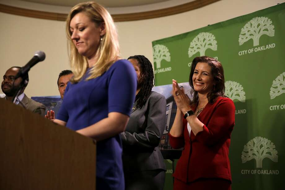 Oakland Mayor Libby Schaaf (right) applauds as Uber's Global Head of People and Places Renee Atwood speaks at the podium during a news conference at Oakland City Hall in Oakland, California, on Wednesday, Sept. 23, 2015. Photo: Connor Radnovich, The Chronicle