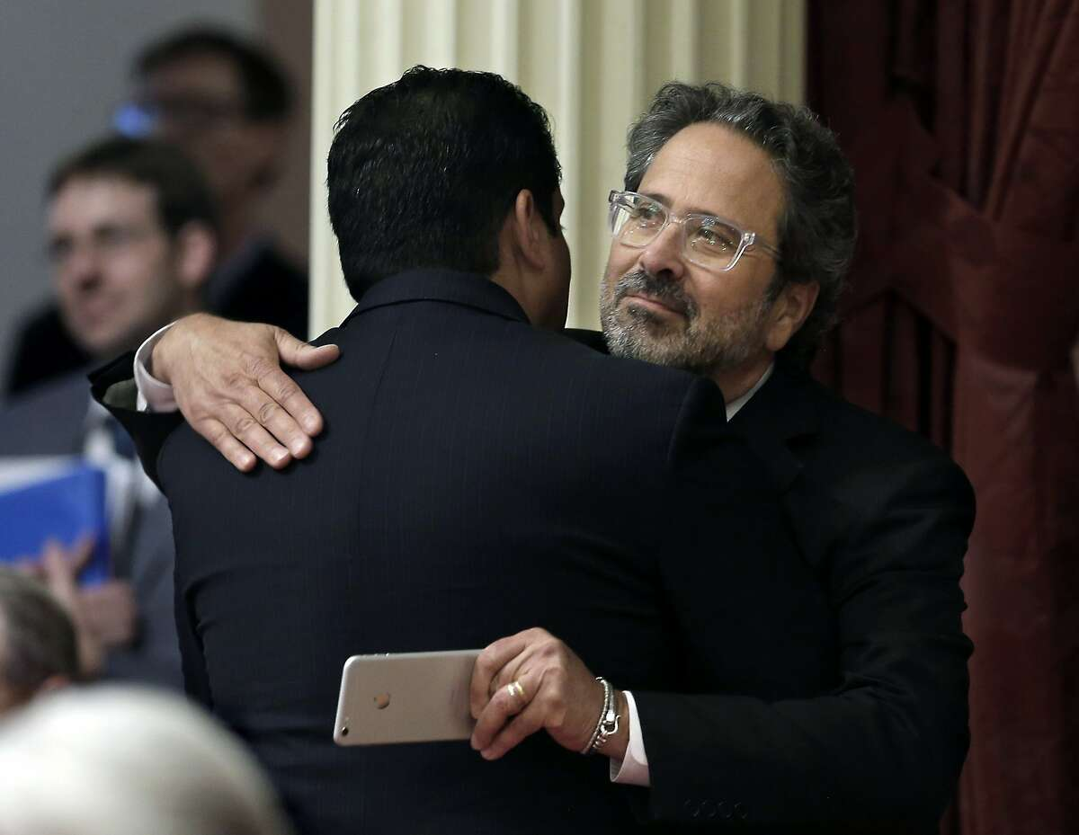 Assemblyman Richard Bloom, D-Santa Monica, right, is congratulated by Sen. Ben Hueso, D-San Diego, after his measure to phase out the use of microscopic beads in personal care products in California was approved by the Senate, Friday, Sept. 4, 2015, in Sacramento, Calif. (AP Photo/Rich Pedroncelli)