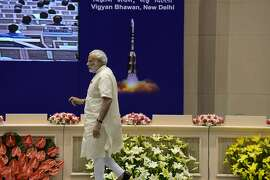 Indian Prime Minister Narendra Modi arrives at a national convention on space technology in New Delhi on September 7, 2015. The Indian Department of Space has organised a national meet centering on tecnology-based tools and applications in governance and development. AFP PHOTO/ PRAKASH SINGHPRAKASH SINGH/AFP/Getty Images