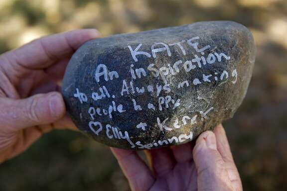 James Steinle the father of  Kate Steinle who was shot and killed on Pier 14 in July, in San Francisco, Calif., holds one of a stones with remarks from people who attended his daughter's memorial service. The hundreds of stones were given back to the parents who said they will make a rock garden containing the special messages at their home.
