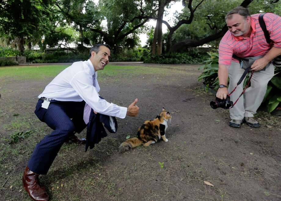 Texas Land Commissioner George P. Bush, left, poses with Bella the official Alamo cat following a news conference earlier this month to celebrate the $31.5 million the General Land Office received to preserve and develop the Alamo. A reader defends Bush for restructuring his office. Photo: Eric Gay /Associated Press / AP