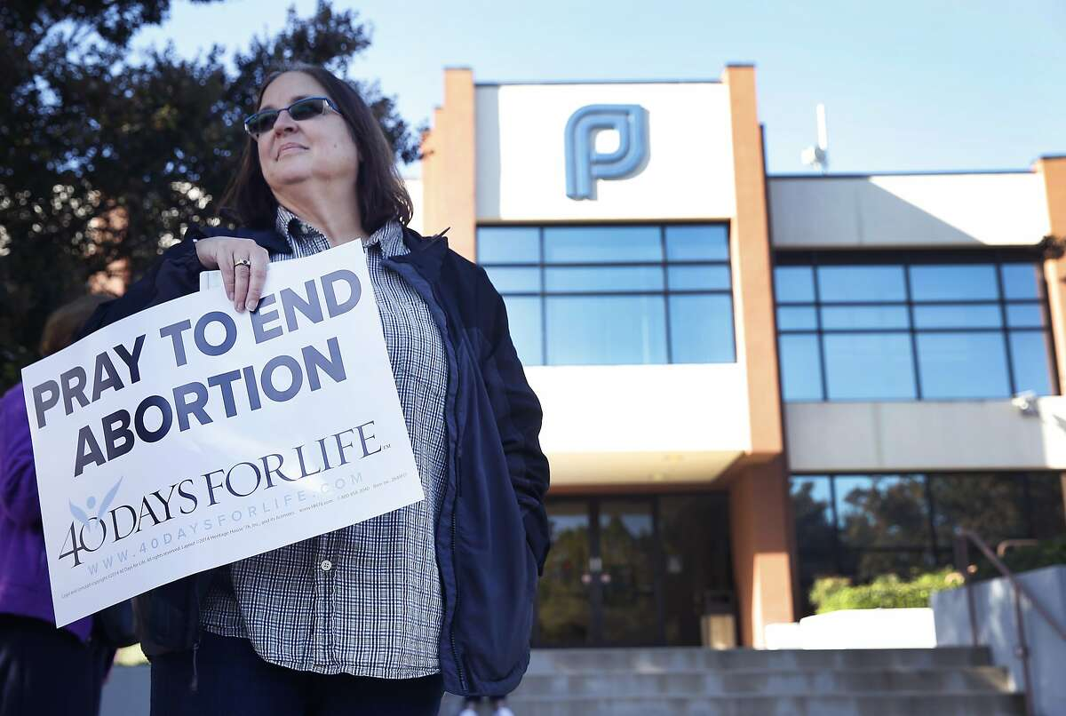 Anne Marie Chrisoulis and other anti-abortion protesters hold a vigil outside of a Planned Parenthood office in San Jose, Calif. on Wednesday, Sept. 23, 2015. The action is part of the nationwide 40 Days For Life movement.