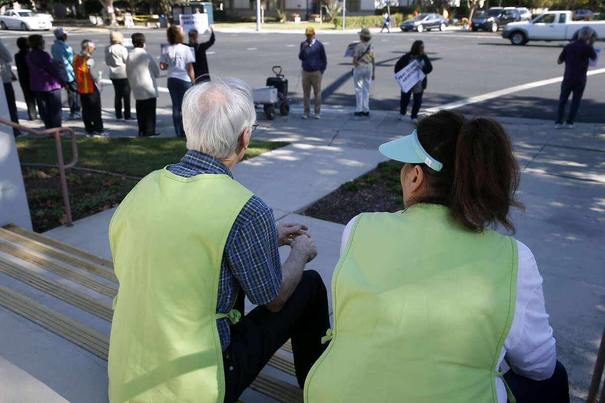 Planned Parenthood volunteers (foreground), who did not want to be named, monitor a demonstration by anti-abortion protesters outside of the Planned Parenthood office on The Alameda in San Jose, Calif. on Wednesday, Sept. 23, 2015. The action is part of the nationwide 40 Days For Life movement.