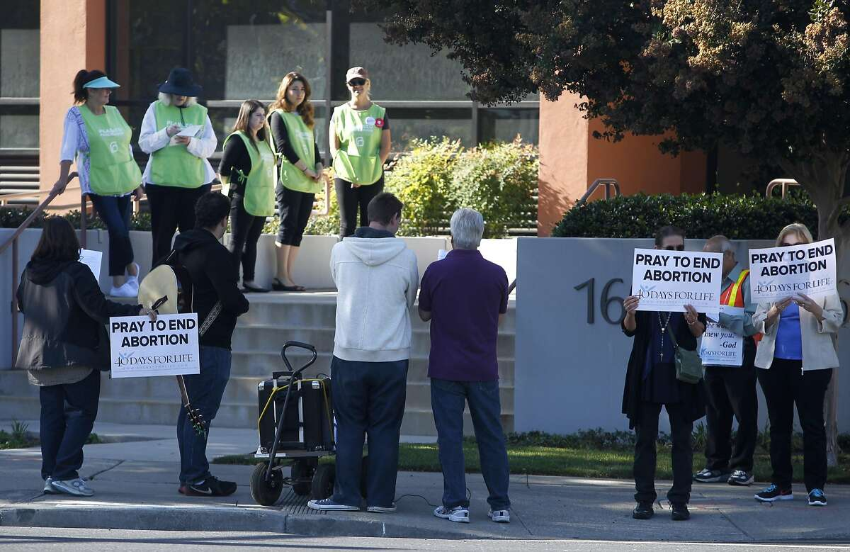 Planned Parenthood volunteers monitor a demonstration by anti-abortion protesters outside of the Planned Parenthood office on The Alameda in San Jose, Calif. on Wednesday, Sept. 23, 2015. The action is part of the nationwide 40 Days For Life movement.