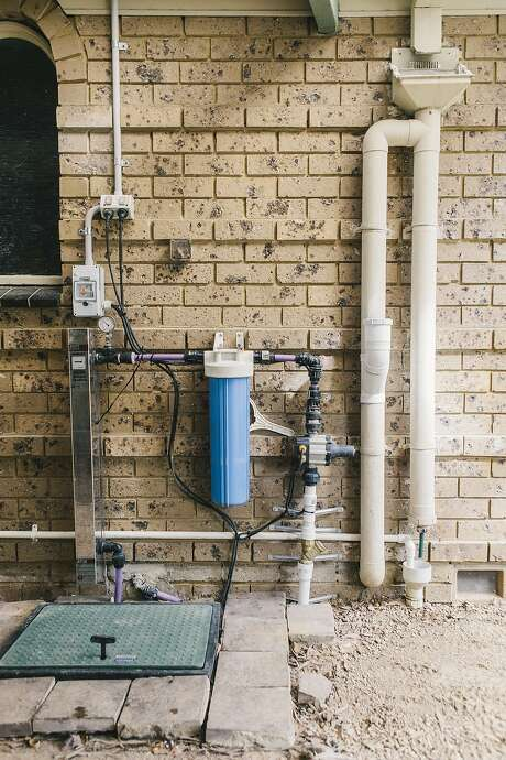 John Harvey, 75, a retired Melbourne homeowner, installed an impressive array of recycling and gray-water systems that have cut his water bill to zero. Photo: Eriver Hijano, Special To The Chronicle