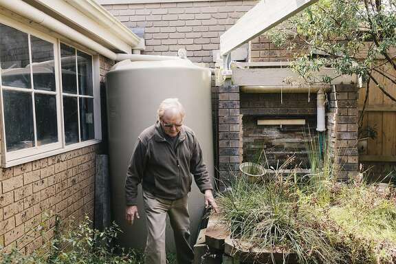 John Harvey, retired Melbourne homeowner who has an impressive array of recycled and grey water installed in his home. Shot in Glen Waverly, Victoria, Australia on September 2, 2015.