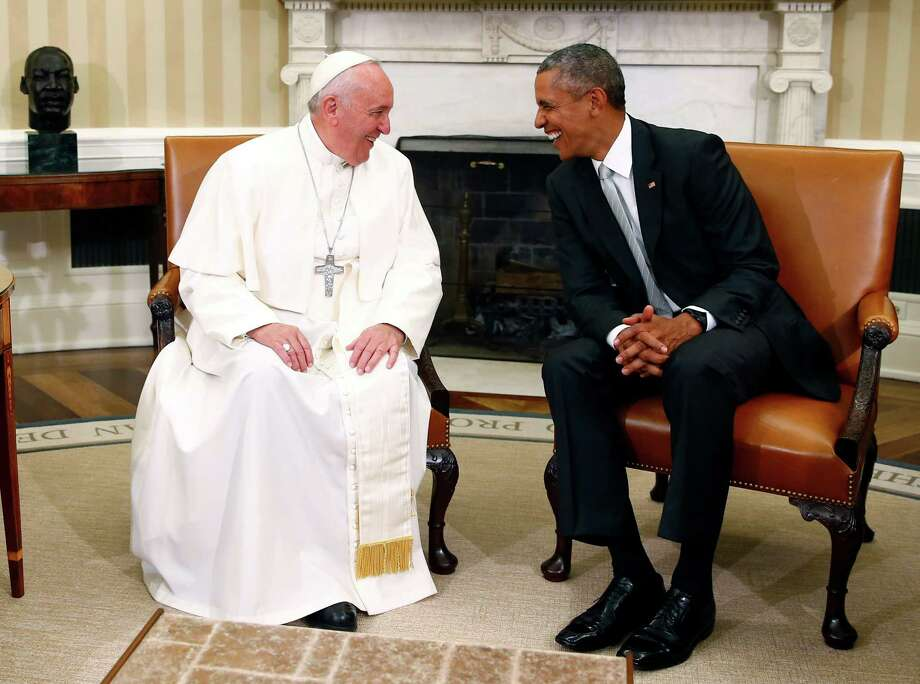 President Barack Obama talks with Pope Francis in the Oval Office of the White House in Washington, Wednesday, Sept. 23, 2015. (Tony Gentile/Pool Photo via AP) Photo: TONY GENTILE, AP / Pool Reuters