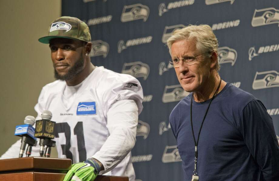Seattle Seahawks' Kam Chancellor, left, and head coach Pete Carroll talk about Chancellor's return to the team after holding out over a contract dispute, during NFL football news conference at the team's headquarters in Renton, Wash., Wednesday, Sept. 23, 2015. Photo: JOHN FROSCHAUER, AP