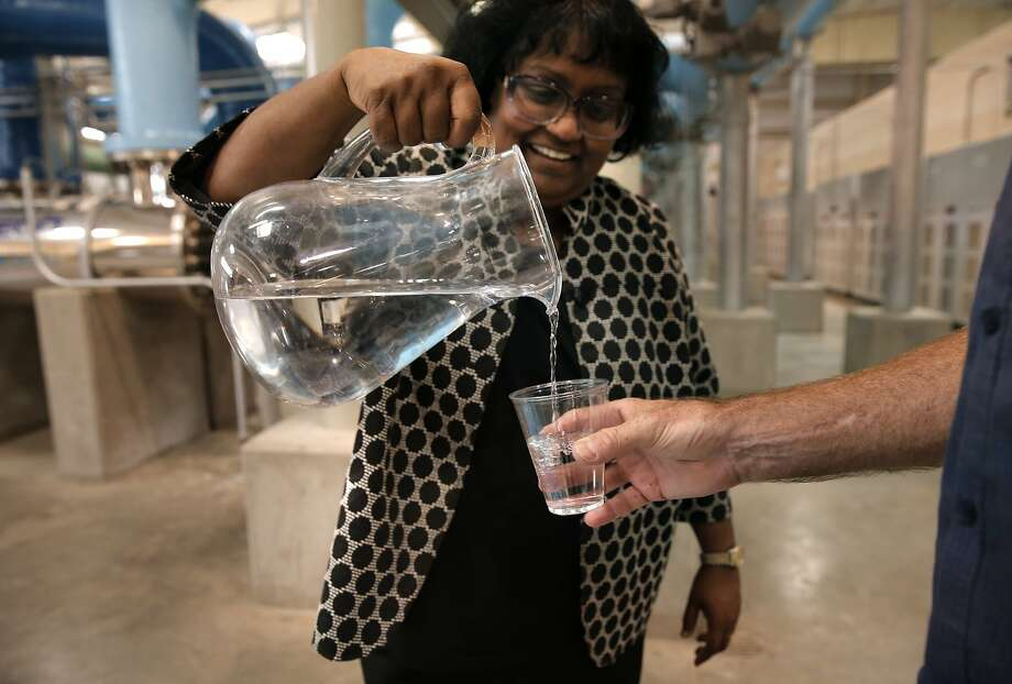 Plant operations manager Pam John pours a drinkable cup of the purified water after it has completed the process at the Silicon Valley Advanced Water Purification Center in San Jose, a demonstration project. Photo: Michael Macor, The Chronicle