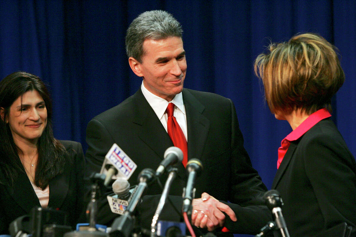 San Antonio City Manager Sheryl Sculley, right, introduces the new Police Chief William McManus and his wife, Lourdes, during a press conference at City Hall on Wednesday, March 15, 2006. ( JERRY LARA STAFF )