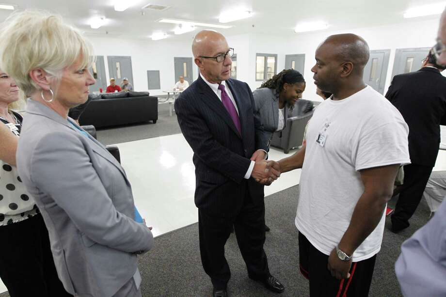 Senator John Whitmire chats with Daryl Day in the Bill Clayton Center Wednesday, Sept. 23, 2015, in Littlefield. TCCO Exchange Board Chair Christy Jack is at left. The state's new home for sex predators, Billy Clayton Center, located in an isolated fly speck of a town in West Texas, looks more like a prison than a treatment center. There are complaints about too-tiny portions of food, lack of treatment programs and commissary, and the nowhere location - some which officials are working to correct, others which they cannot. Fact: After a two-year search, this was the only place the state could find to house them.  ( Steve Gonzales / Houston Chronicle ) Photo: Steve Gonzales, Staff / Houston Chronicle / © 2015 Houston Chronicle