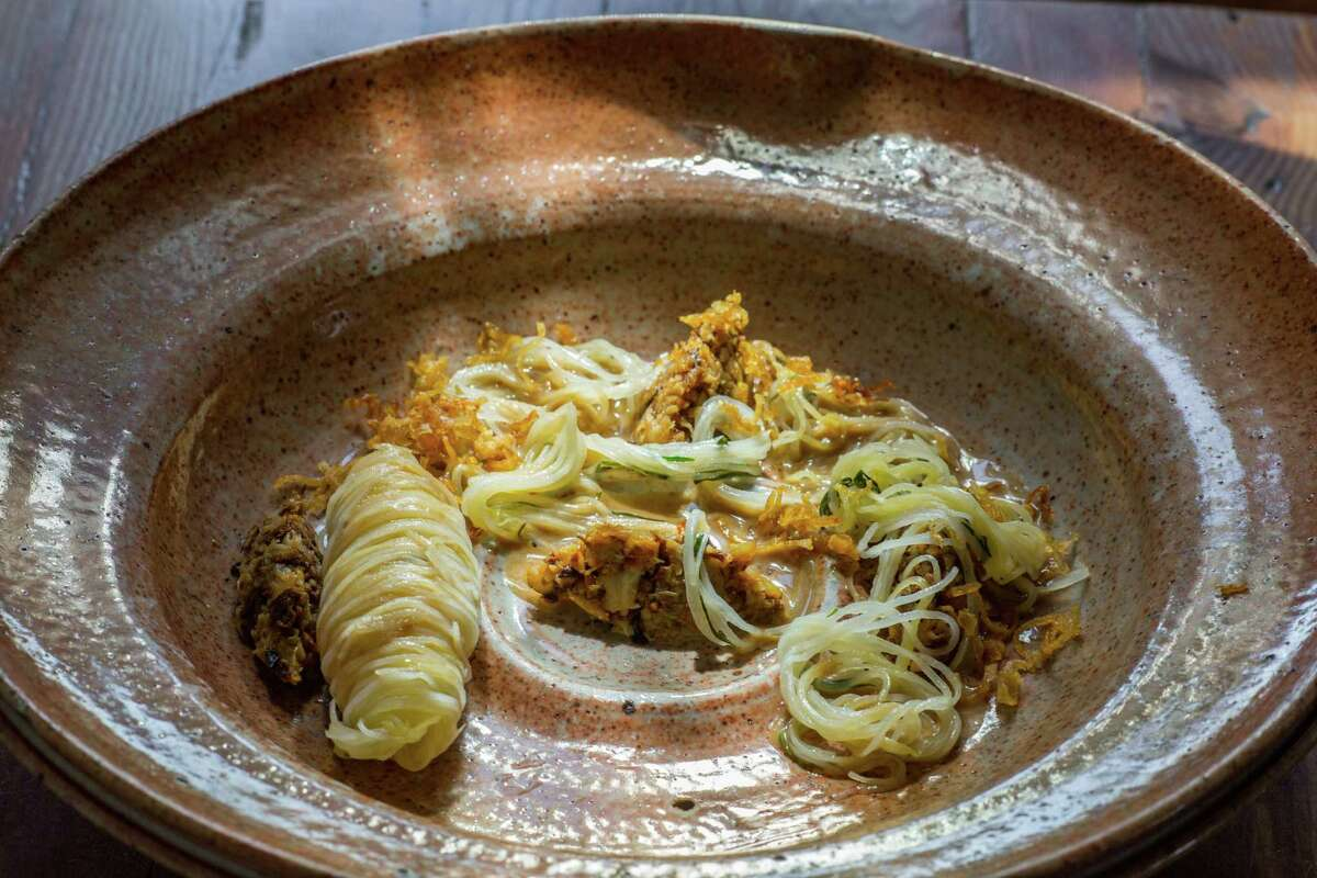 Oxheart's new potatoes cooked several different ways with roasted cabbage condimento, dried potato skin sauce.