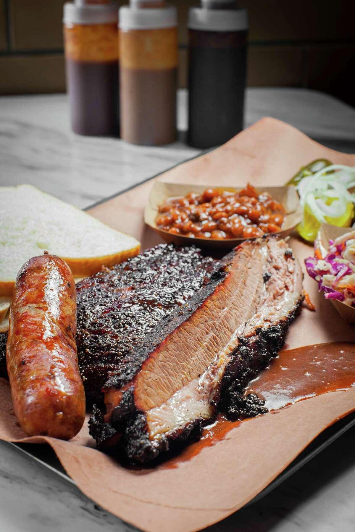 Killen's BBQ's sausage link, pork ribs, beans and coleslaw.