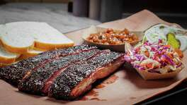 NOTE: THIS PHOTO IS FOR TOP 100 RESTAURANTS GUIDE. DO NOT USE BEFORE 09/24/2015. A display of barbecue at Killen's Barbecue in Pearland. Killen's BBQ's pork ribs, beans and coleslaw. Photographed, Thursday, July 16, 2015, in Pearland. ( Nick de la Torre )