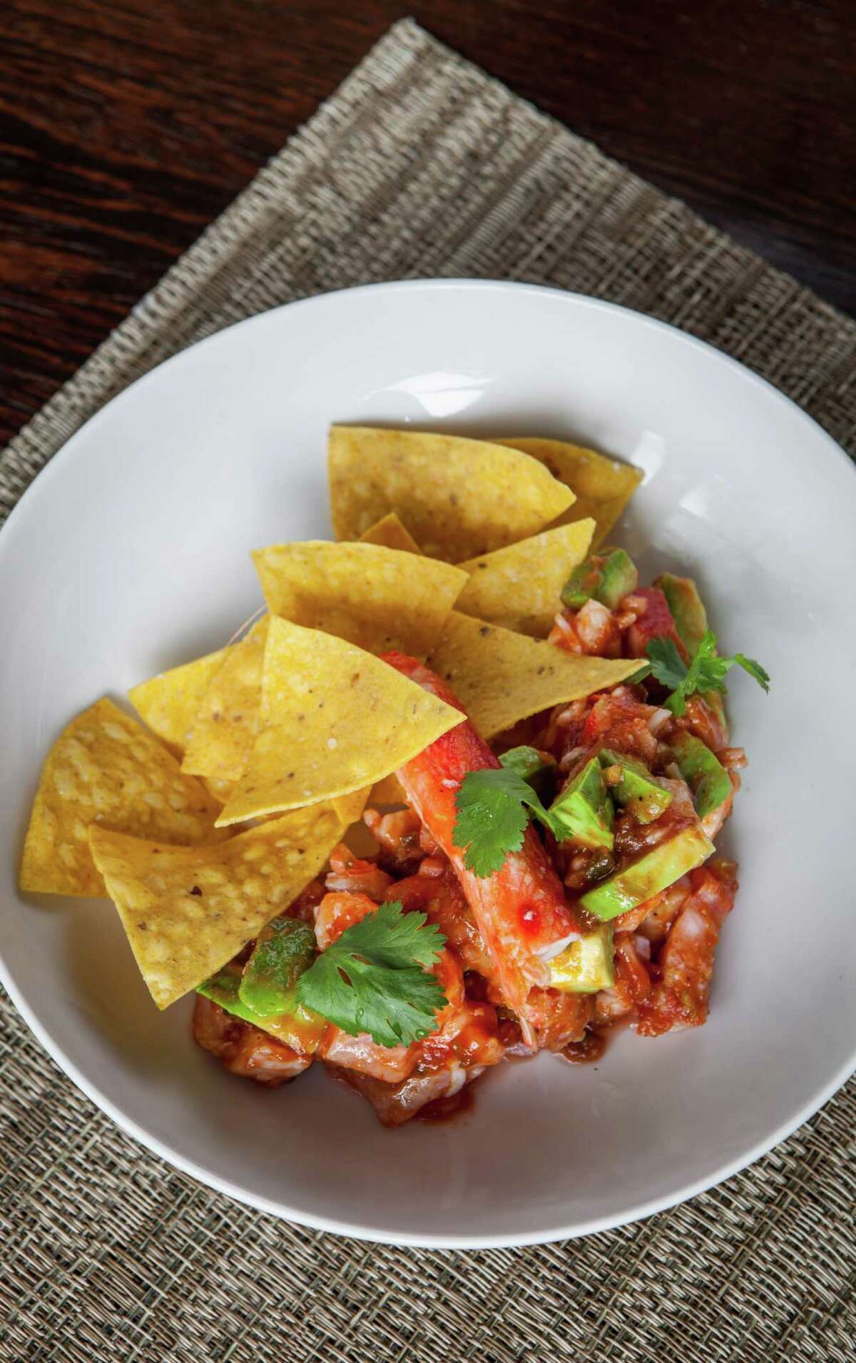 Triniti: Campechana with crab, flounder, shrimp, tomatoes, chiles, avocado and tortilla chips