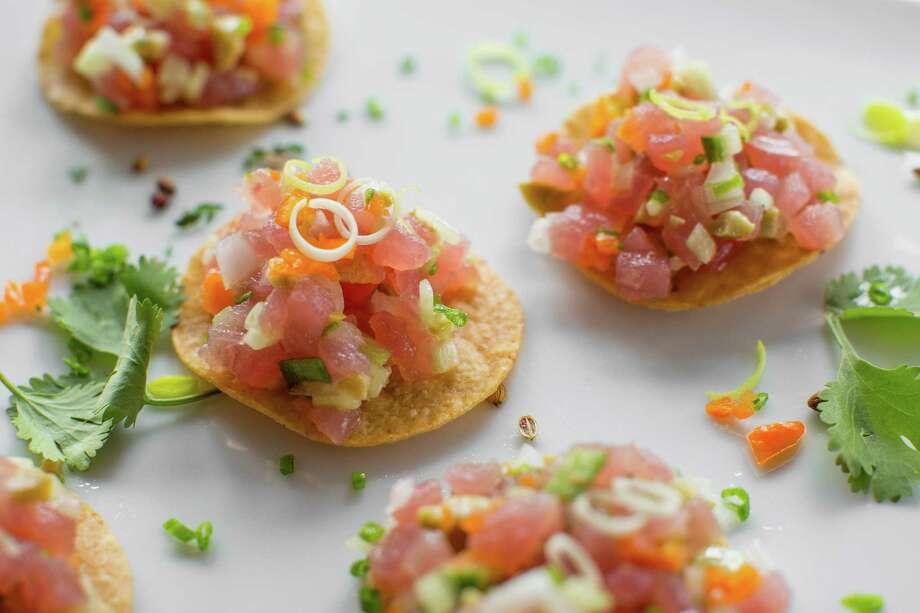 Caracol: Tostada de Atún Crudo (Tuna tostada with sour orange mayonnaise and leeks). Photo: Nick De La Torre, For The Chronicle / ONLINE_YES