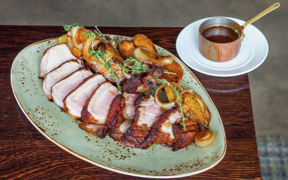 Triniti: Pork chop for two with cider brine and cider-glazed apples Photo: Nick De La Torre, For The Chronicle / ONLINE_YES
