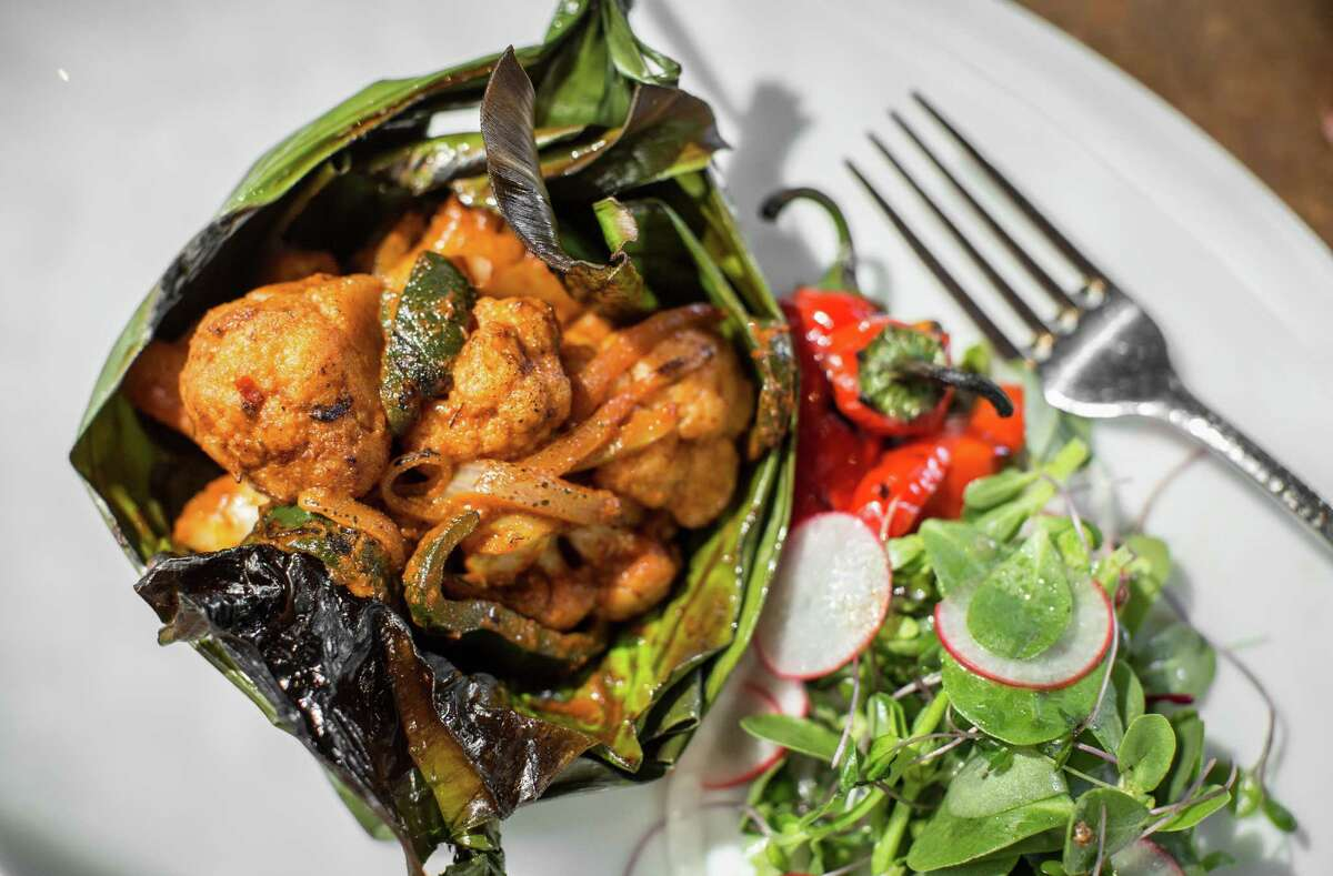 Hugo's: Barbacoa de Coliflor (cauliflower steamed in banana leaves with ancho chili sauce)
