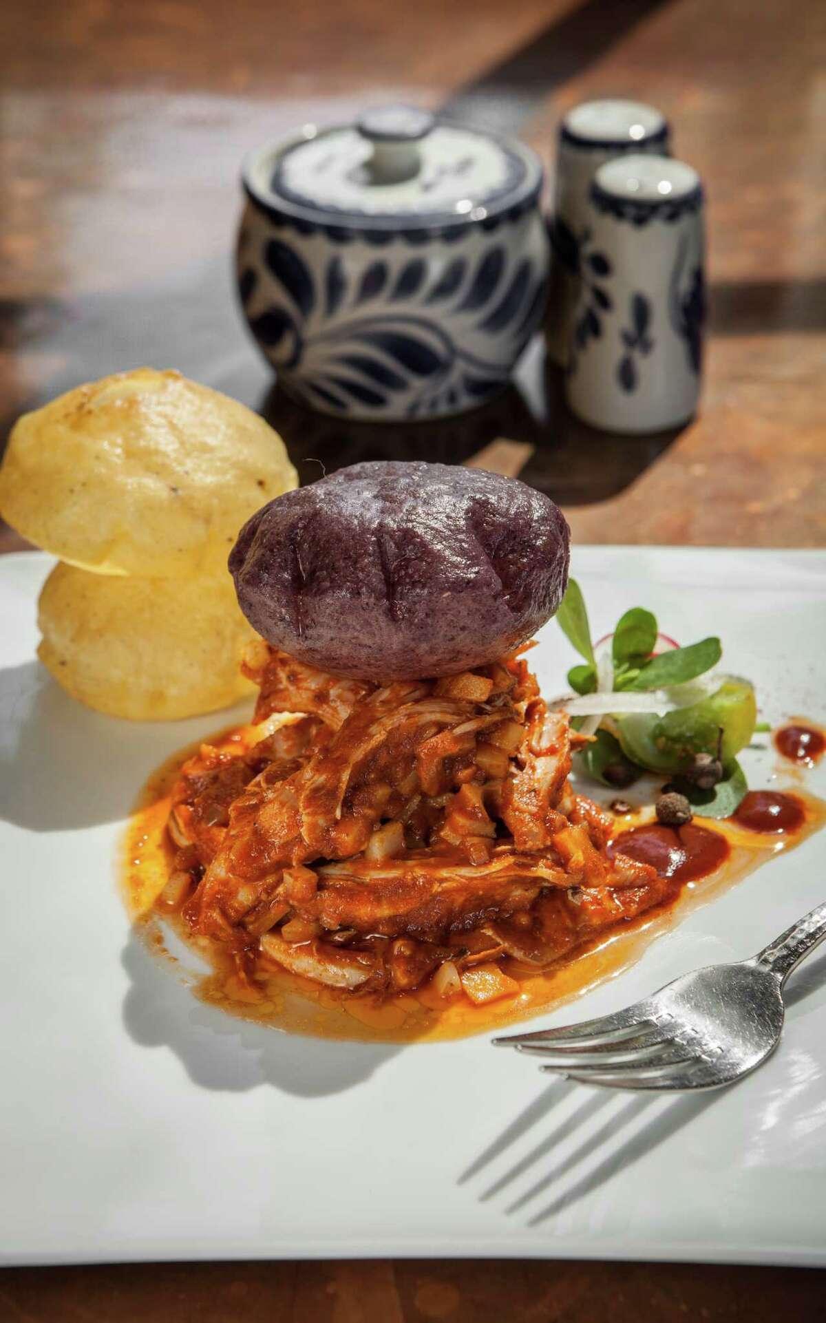 Hugo's: Infladita con Tinga de Conejo (puffed tortilla with shredded rabbit and chorizo).