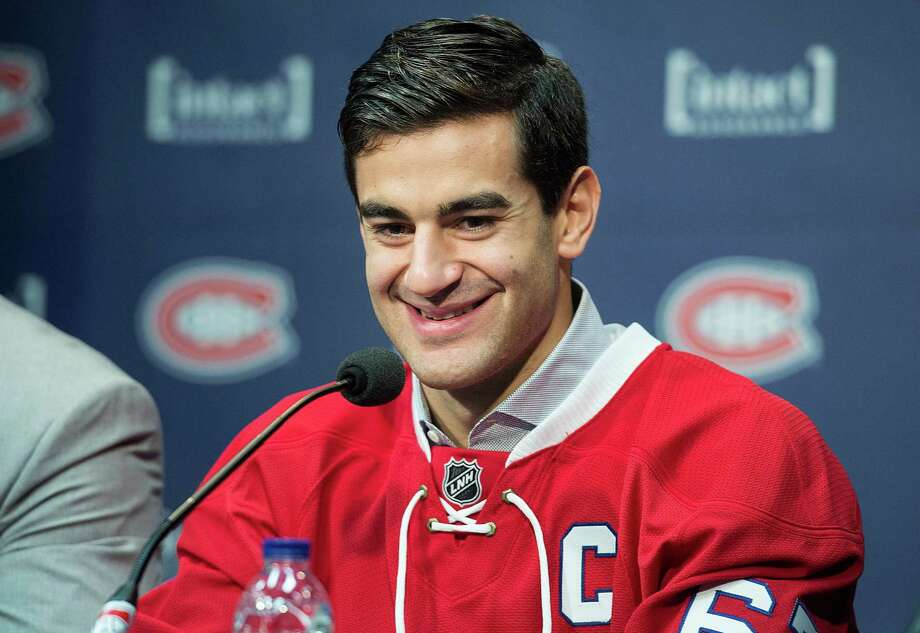 Montreal's Max Pacioretty, a New Canaan native, smiles during a news conference naming him as the new captain of the Canadiens On September 18 in Brossard, Quebec. Photo: Graham Hughes / Associated Press / CP