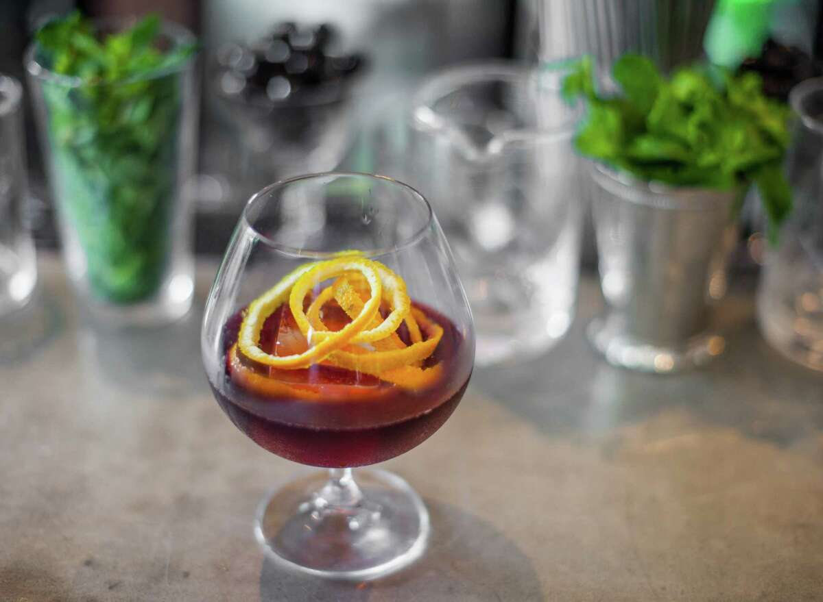 Coltivare: Negroni Sbagliato cocktail Coltivare's Negroni Spagliato, Campari, carparo antica, lambrusco rosso and satsuma bitters.