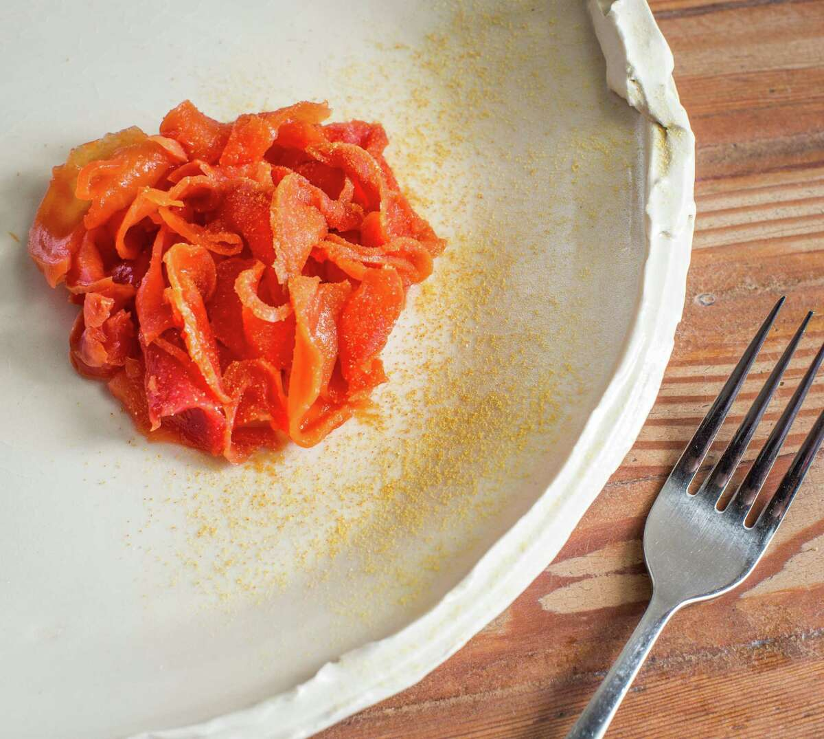Oxheart's dried beets soaked in citrus juice, with lime leaf, 'red' shiso and dried mandarin peel.