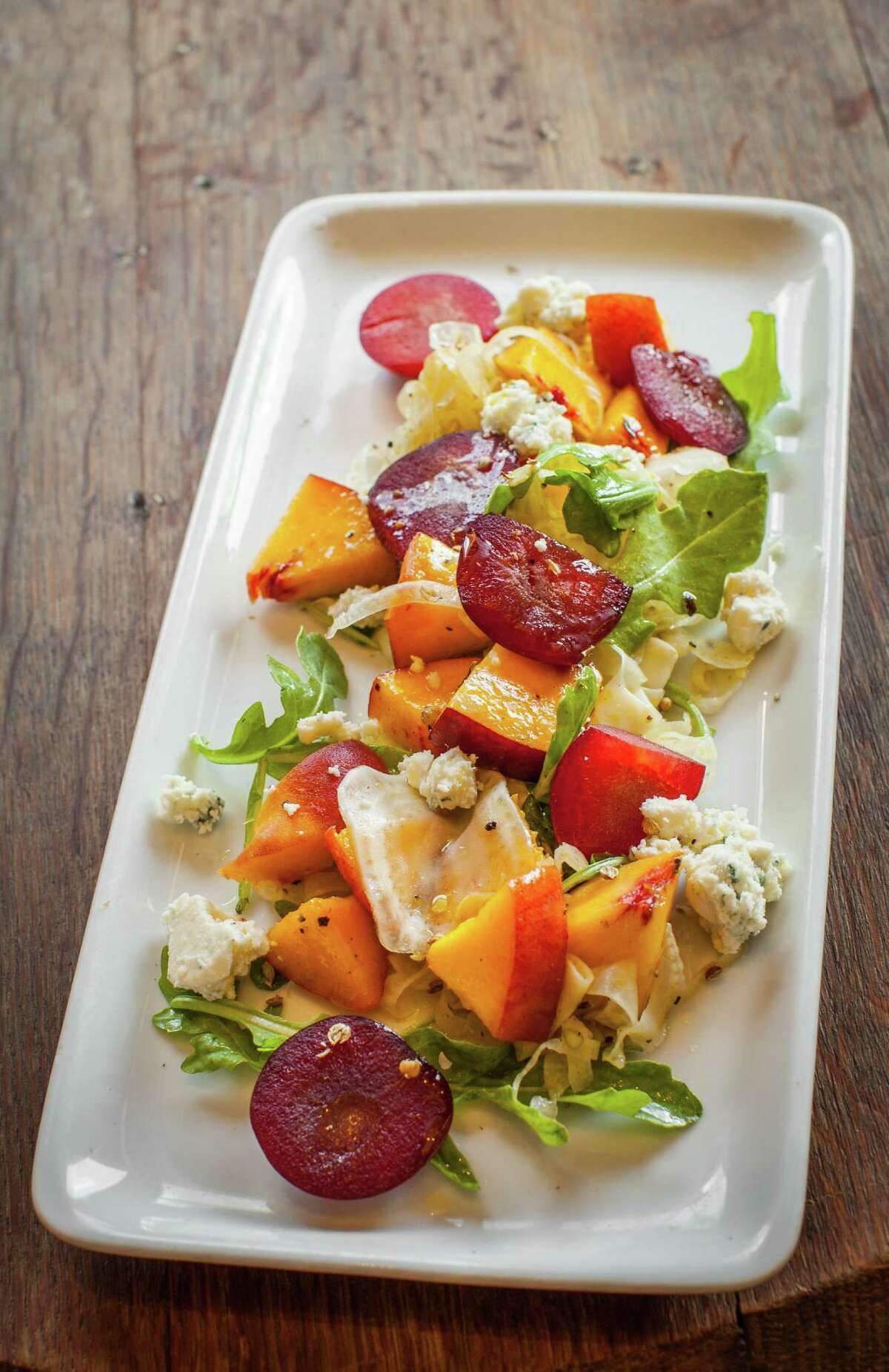 Coltivare: Salad of Texas peaches, red plums, fennel, Point Reyes blue cheese and mizuna greens Coltivare's texas peaches, red plums, fennel, pt. reyes blue and mizzen.
