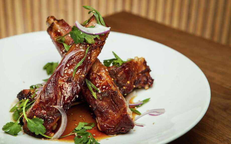 Underbelly's ham ribs with sorghum mustard glaze.  Photo: Nick De La Torre, For The Chronicle / ONLINE_YES