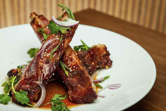 THIS IS FOR TOP 100 RESTAURANTS GUIDE; PLEASE DO NOT USE BEFORE 9/24/2015. Underbelly's ham ribs with sorghum mustard glaze. Photographed, Tuesday, June 2, 2015, in Houston. ( Nick de la Torre   )