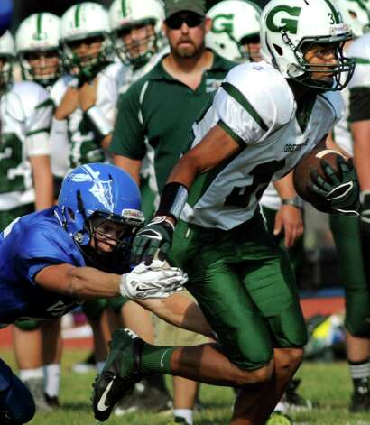 Greenwich's Cole Burgess, right, fights off a tackle from Hoosic Valley's Ryan Rifenburg  during their football game on Saturday, Sept. 19, 2015, at Hoosic Valley High in Schaghticoke, N.Y. (Cindy Schultz / Times Union) Photo: Cindy Schultz / 00033404A