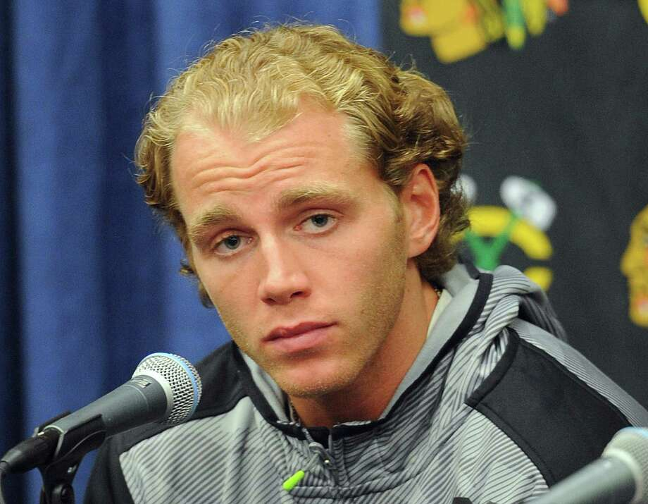Chicago Blackhawks' Patrick Kane listens during a media availability on the first day of NHL hockey training camp at the Compton Family Ice Center on the campus of the University of Notre Dame in South Bend, Ind., Thursday Sept. 17, 2015 (AP Photo/Joe Raymond) ORG XMIT: INJR205 Photo: Joe Raymond / FR25092 AP