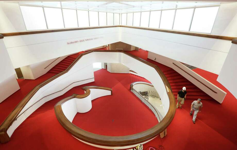 The Alley Theatre has completed its first major renovation since its opening, boasting bold red carpet and a sweeping staircase. Photo: Jon Shapley, Staff / © 2015 Houston Chronicle