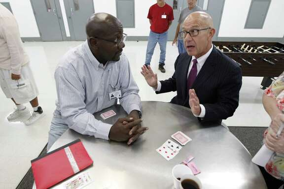 Senator John Whitmire  talks with Ronald Mitchell in the Bill Clayton Center Wednesday, Sept. 23, 2015, in Littlefield. The state's new home for sex predators, Billy Clayton Center, located in an isolated fly speck of a town in West Texas, looks more like a prison than a treatment center. There are complaints about too-tiny portions of food, lack of treatment programs and commissary, and the nowhere location - some which officials are working to correct, others which they cannot. Fact: After a two-year search, this was the only place the state could find to house them.  ( Steve Gonzales / Houston Chronicle )