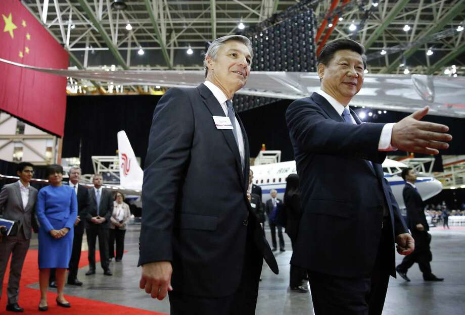 SEATTLE, WA - SEPTEMBER 23:  Chinese President Xi Jinping (R) and Ray Conner (L) , president and CEO Boeing Commercial Airplanes, tour the Boeing assembly line on September 23, 2015, in Seattle, Washington. The Paulson Institute, in partnership with the China Council for the Promotion of International Trade, co-hosted the event. (Photo by Jason Redmond-Pool/Getty Images) Photo: Pool, Pool / Getty Images / 2015 Getty Images