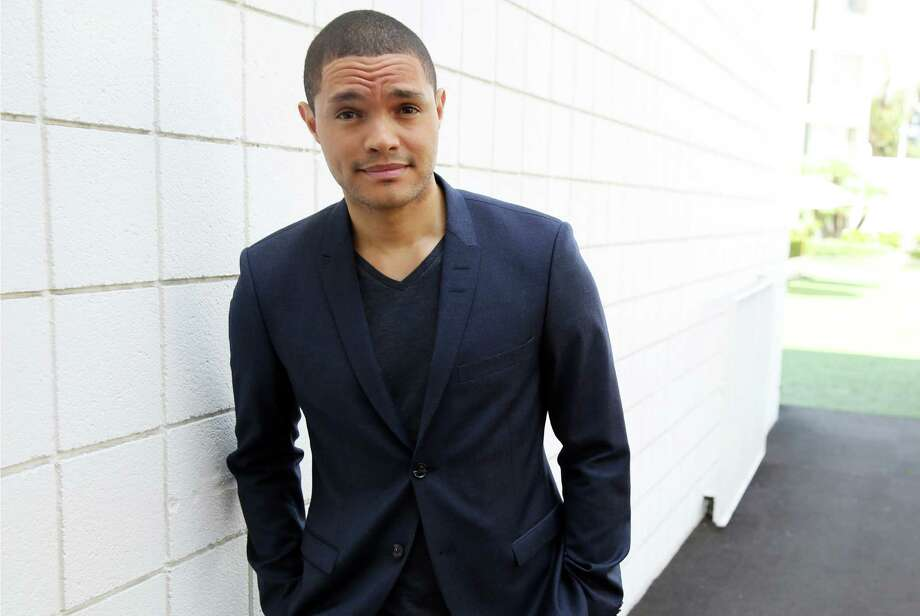 "FILE - In this July 29, 2015 file photo, Trevor Noah, host of the new ""The Daily Show with Trevor Noah,"" poses for a portrait in Beverly Hills, Calif.  The show will premiere on Monday, Sept. 28, on Comedy Central.  (Photo by Matt Sayles/Invision/AP, File) ORG XMIT: NYET139 Photo: Matt Sayles / Invision"
