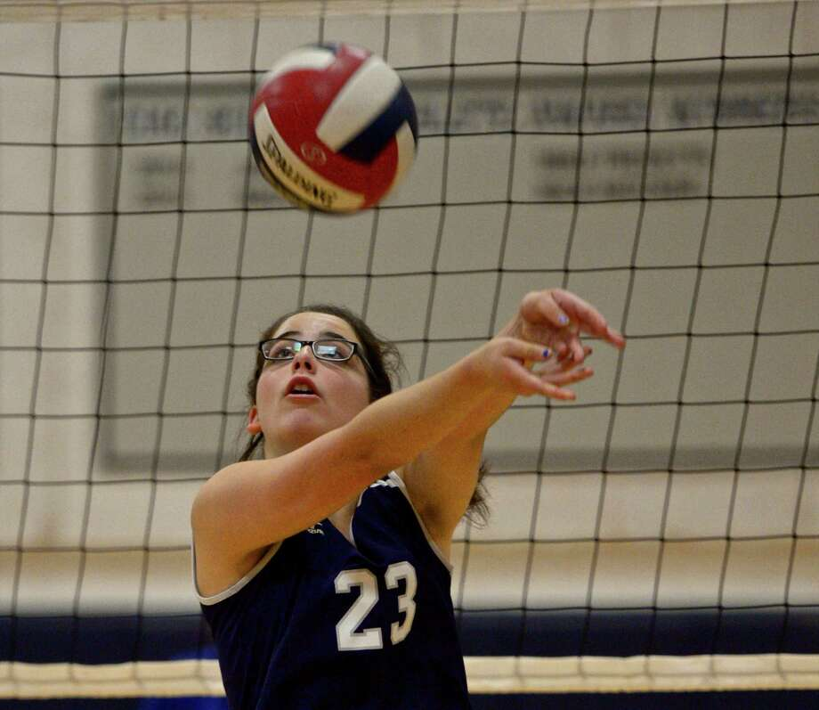 Immaculate's Emma Connolly (23) bumps the ball during the girls high school volleyball match between Henry Abbott Technical and Immaculate high school on Wednesday afternoon, September 23, 2015, at Immaculate High School, in Danbury, Conn. Photo: H John Voorhees III / Hearst Connecticut Media / The News-Times