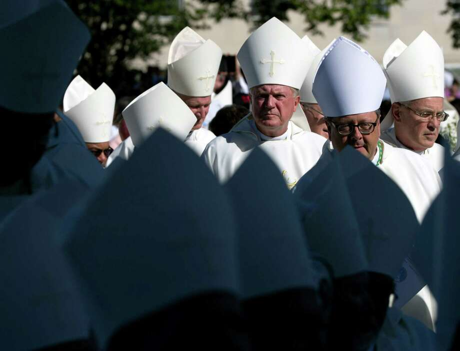 Bishops arrives at the Basilica of the National Shrine of the Immaculate Conception in Washington, Wednesday, Sept. 23, 2015, for the Canonization Mass. (AP Photo/Alessandra Tarantino). Photo: Alessandra Tarantino, STF / Associated Press / AP