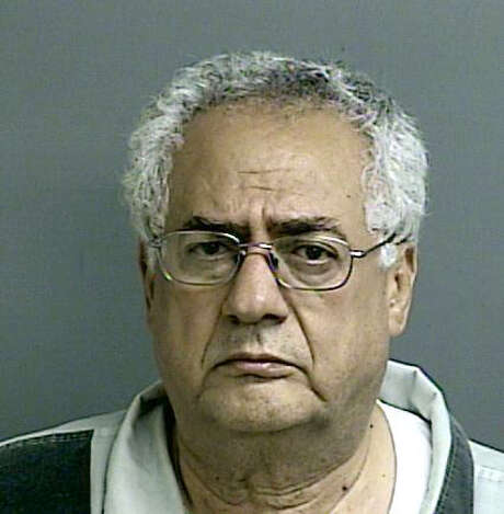 Dr. Rezik Saqer was arrested Tuesday night, Sept. 22, 2015, in connection with a car crash near Lake Conroe that left four members of a family dead. 68-year-old Roland Cooper was charged with four counts of intoxicated manslaughter and two counts of intoxication assault following the three-vehicle wreck.
