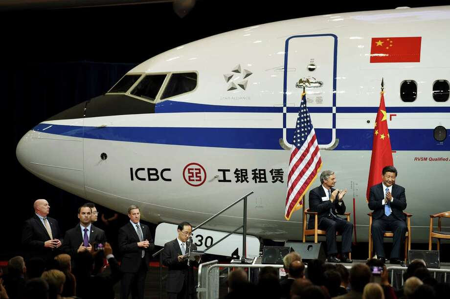 Chinese President Xi Jinping, right, with president and CEO of Boeing Commercial Airplanes Ray Conner meet after touring the Boeing assembly line, Wednesday, Sept. 23, 2015 in Everett, Wash. Boeing has agreed to buy 300 jets from Boeing. In addition, state-owned Commercial Aircraft Corp. of China signed a cooperation agreement with the aerospace giant to build a 737 aircraft assembly center in China. (Mark Ralston/Pool Photo via AP) ORG XMIT: NYMV103 Photo: Mark Ralston / Pool AFP