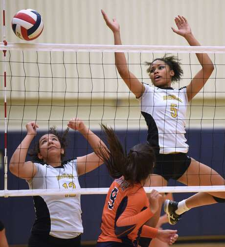 Savannah Garza (12) and Arabella Hall (5) of Brennan block a shot by Lauren Martinez (9) of Brandeis during District 27-6A high school volleyball action at Taylor Field House on Wednesday, Sept. 23, 2015. Photo: Billy Calzada, Staff / San Antonio Express-News / San Antonio Express-News