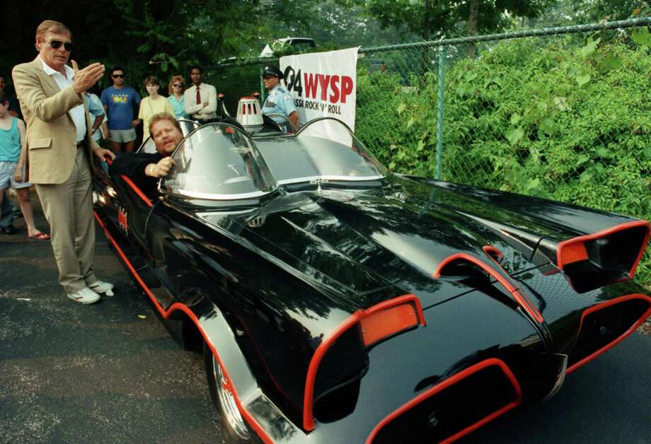 "Adam West, left, is shown in 1989 looking over the Batmobile he drove in the ""Batman"" TV series in the 1960s. A court ruled Wednesday that the Batmobile is entitled to copyright protection.  Photo: Cristy Rickard, STR / AP"