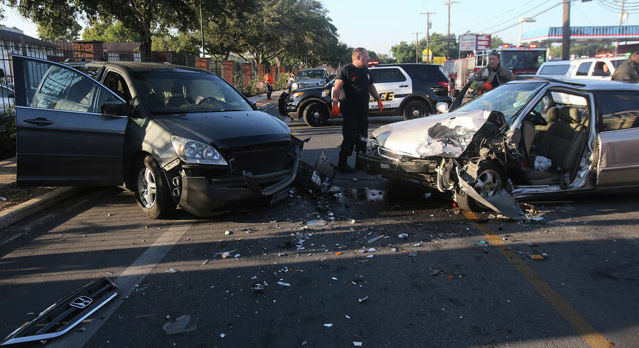 San Antonio firefighters prepare to remove an accident victim involved on a head on collision about 8:00 a.m. Wednesday September 23, 2015 on the 8,000 block of Midcrown near Walzem Road. The accident involved a mini van and a four door Honda. An Air Life helicopter landed at nearby Roosevelt High School shortly after the accident. The accident is currently being investigated. Photo: John Davenport, Staff / San Antonio Express-News / ©San Antonio Express-News/John Davenport