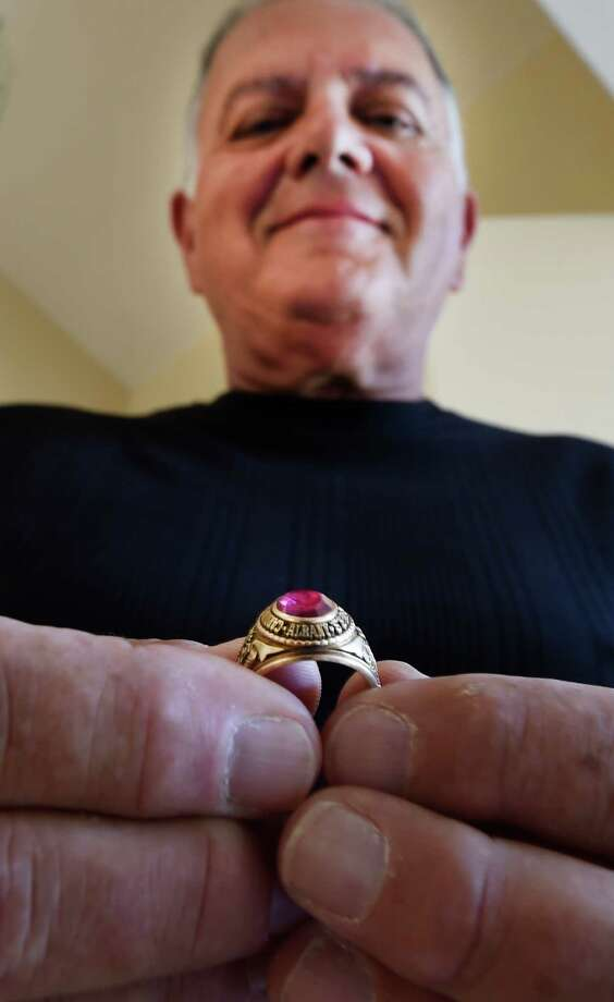 Michael Panucci holds his 1968 Cardinal McCloskey High School class ring that was returned to him Wednesday afternoon, Sept. 23, 2015, at his home in Halfmoon, N.Y. An anonymous person found the ring and sent it to the Times Union in the hope that we could locate its rightful owner and return it to them. (Skip Dickstein/Times Union) Photo: SKIP DICKSTEIN / 10033479A
