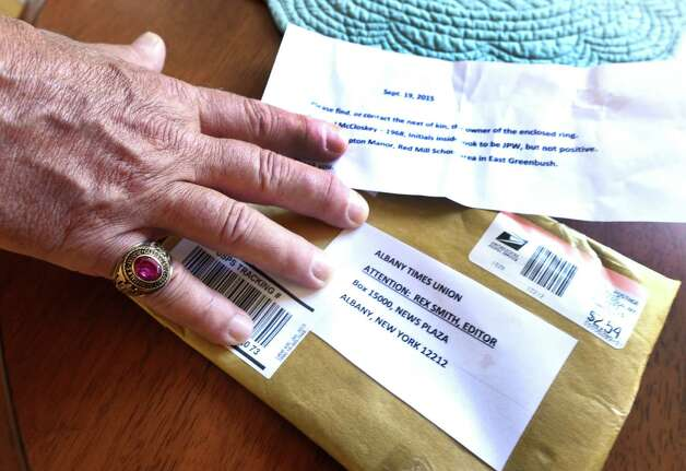 Michael Panucci opens a package that was sent to the Times Union which contained his 1968 Cardinal McCloskey High School class ring Wednesday afternoon, Sept. 23, 2015, at his home in Halfmoon, N.Y. An anonymous person found the ring and sent it to the Times Union in the hope that we could locate its rightful owner and return it to them. (Skip Dickstein/Times Union) Photo: SKIP DICKSTEIN / 10033479A