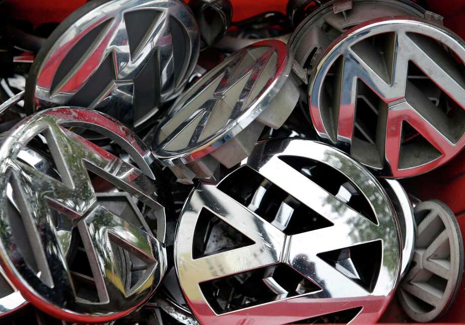 """A Berlin scrap yard has VW ornaments. Some fear that the """"Made in Germany"""" brand could suffer because of the emissions scandal. Photo: Michael Sohn, STF / AP"""