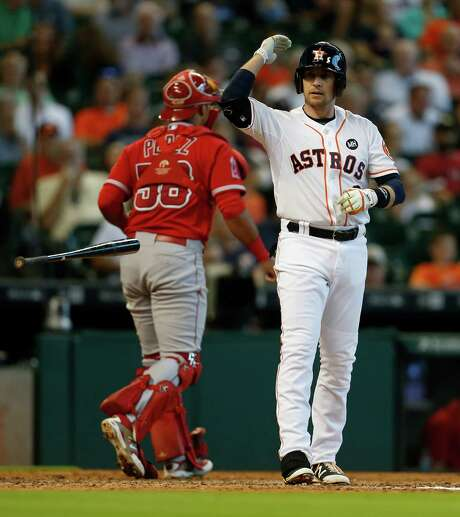 This strikeout in the third inning typified Jed Lowrie's 0-for-5 day at the plate Wednesday. He also made the game-ending out. The Astros stranded eight runners one day after leaving 11 on base, resulting in two critical losses to the fast-closing Angels. Photo: Karen Warren, Staff / © 2015 Houston Chronicle