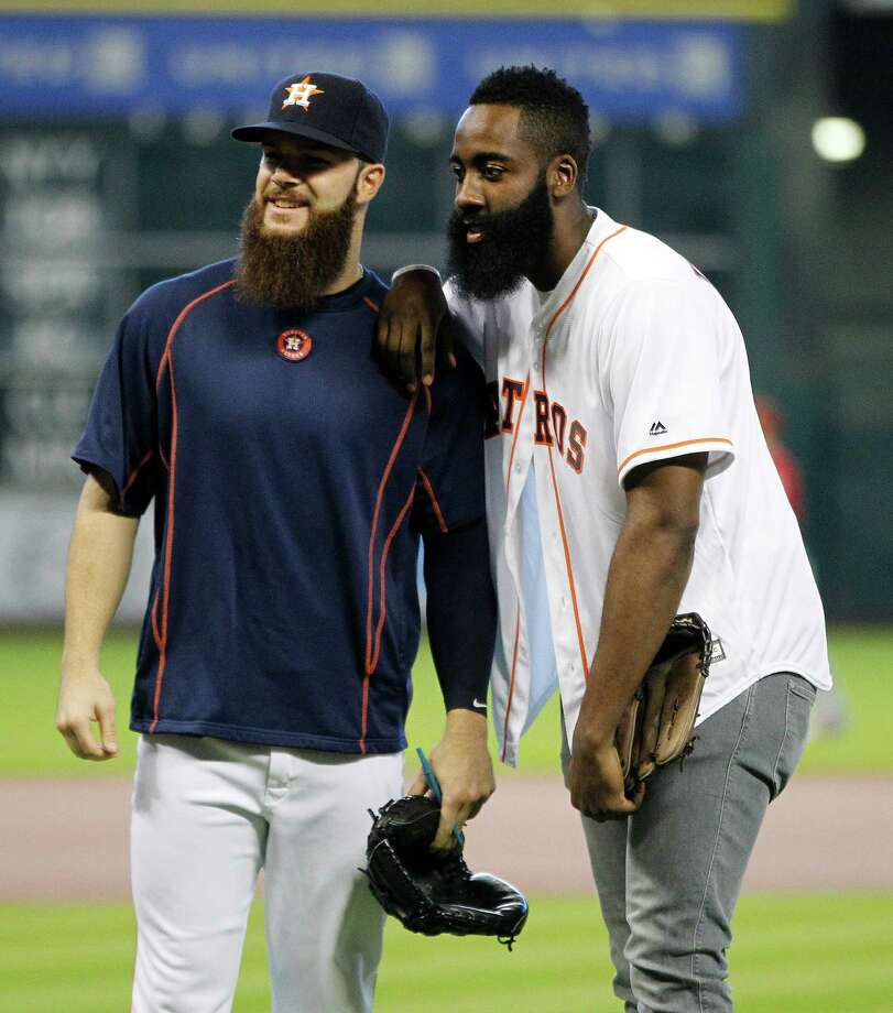 In a battle of the beards, it was Dallas Keuchel, left, by a hair over Rockets star James Harden, who threw out the first pitch before Wednesday's game. Photo: Karen Warren, Staff / © 2015 Houston Chronicle